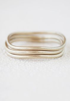 "Metallic Meaning Bangles 15.99 at shopruche.com. Three undulating antiqued brass bangles with charming imperfections create the perfect set of understated bangles.2.75"" diameter"