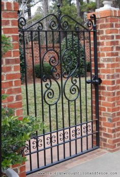 iron gate with brick pillars
