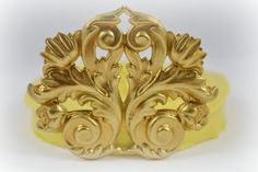0370 Mirror Image Acanthus Leaves Flourish by MasterMolds on Etsy, $8.00  This flourish medallion would be gorgeous in fondant on a wedding cake