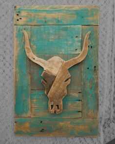 This cow skull is made from recycled pallet wood, and it is mounted on a painted plaque that is also made of pallet wood. It is approximately 15x23 inches and it comes with a hanger on the back.