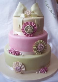Rossette and Brooch Wedding Cake By Cupcakesplus on CakeCentral.com - Beautiful to be used as Birthday cake...