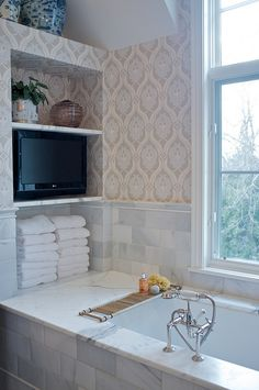 Could do this in a master bath. Bottom for towels, middle shelf for speakers for music, top shelf for decor. House Bathroom, Bathroom Inspiration, Small Bathroom, Bathtub Design, Tv In Bathroom, Bathroom Decor, Home, Dream Bathrooms, Bathroom Design