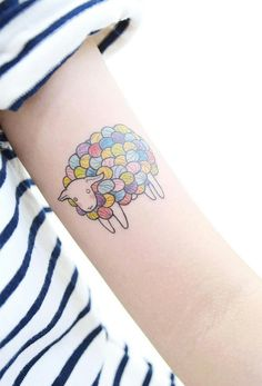Colourful sheep tattoo