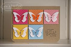 handmade card ... kraft base ... squares in 2 X 3 block pattern ... luv the precise placement ... layered punched butterflies ... the largest just touches the edge of the square at the tip of the wings ... striped paper square matches color of the smaller butterfly ... sentiment stamped in corner with missing squatre .. like this card!!
