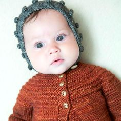 Misha and Puff — bobble bonnet http://www.pinterest.com/catherinevberg/baby-baby-wear-and-stuff/