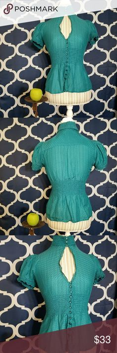 🌻🌺🌻BEBE 2B SILK BLEND BLOUSE!! BEBE 2B SILK BLEND BLOUSE-NWOT!! Size XS but can fit a small as well. No flaws, never worn. This blouse is soft with silk and chic with a keyhole cutout in the front. Scrunched up with elastic below the bust and around the neck where it can also unbutton. Love this blouse and is a great teal color! Posh Ambassador, buy with confidence!  Check out my other items to bundle and save on shipping!  Reasonable offers welcome! I ship same or next day!    Inventory…