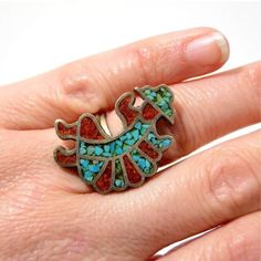 VTG Zuni Sterling Silver Rainbow Dancer Ring Beautiful Large Vintage Sterling Silver Zuni Rainbow Dancer Turquoise & Red Coral Ring. Size 5. Tested and confirmed 925 Sterling silver. Measures 27.0mm at widest point by 2.4mm at skinniest point. A conversation piece for sure! A collectible Navajo ring! Would be great for anyone that loves vintage Sterling jewelry! Thanks for looking! I appreciate your interest! Have a blessed day! Please make reasonable offer using offer button. Buy w…