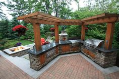 Let's add living colors to your lawn by designing it with this captivating outdoor kitchen project. This splendid outdoor kitchen is borrowing the whole beauty from the wooden pergola to the stylish fireplace arrangement. The outdoor area looks more pleasant with this live kitchen plan that you have designed for your wonderful family time.