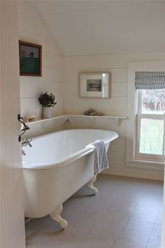 Sheila Narusawa overhauled this cottage bathroom with a wraparound open shelf, a white clawfoot tub, and painted wood floors. See the rest of the house in A Cottage Reborn in Coastal Maine.White Bathrooms from the Remodelista Architect/Designer Directory Bad Inspiration, Bathroom Inspiration, Home Interior, Interior Design, Bathroom Interior, Interior Decorating, Decorating Ideas, Decorating Bathrooms, Stylish Interior