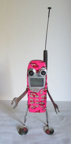 Hey, I found this really awesome Etsy listing at https://www.etsy.com/listing/209727297/smoochy-found-object-robot