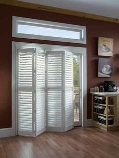 Use sliding closet door/room divider for sliding glass door- no more venitian blinds!