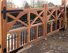 If you're after a unique look to your entrance, we can design, supply and install beautifully crafted bespoke automated wooden gates. Farm Entrance, Driveway Entrance, Entrance Gates, Garden Gates And Fencing, Fences, Wooden Fence Gate, Gate Post, Farm Plans, Electric Gates