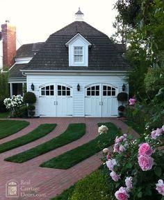 Amazing garage doors and landscaping