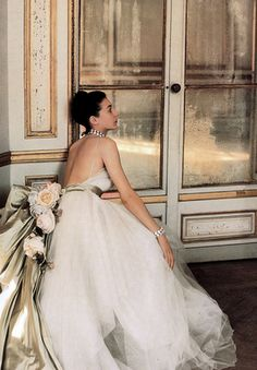 A handful of roses and a mass of pearl-colored satin on tulle, Dior's evening gown, photo by Louise Dahl-Wolfe at the Chateau de Madrid, 1947