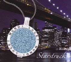 Sterling silver locket and chain with interchangeable crystal coin center