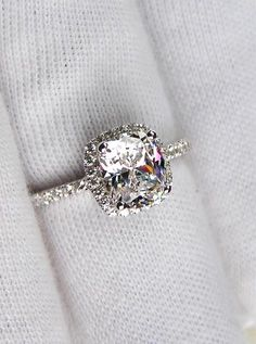 Halo. Cushion cut. Engagement ring.
