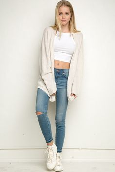Crop top, baggy sweater, denim.