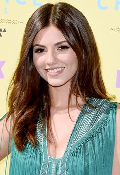 Victoria Justice's sleek, shiny strands parted down the middle and a perfect brown-nude lip