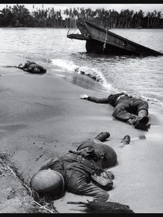 Three American soldiers lie half-buried in the sand at Buna Beach on New Guinea. This photo was taken in February 1943, but not published until September, when it became the first image of dead American troops to appear in LIFE during World War II. George Strock's photo was finally OK'd by government censors, in part because FDR feared the public was growing