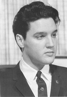 Taken at a banquet held in Elvis' honor for appreciation for a benefit concert at Ellis Auditorium in Memphis on February 25, 1961.
