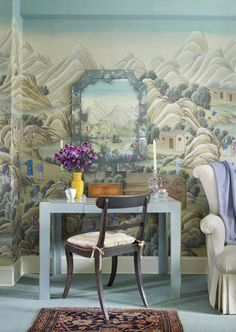 Chinoiserie Chic: Easy Chinoiserie DIY. Chinese landscape wallpaper behind a small vanity seating area.