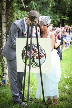 Key lock bridge inspired alternative to unity candle  in wedding ceremony. Couple was engaged on key lock bridge in Paris. Jenica+Josh Photo By Sherry Sutton Photography