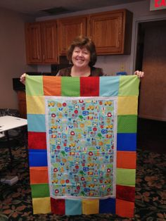 PugMom Quilts!: Sue and her Alphabet panel quilt. Shown at Cape Cod quilt weekend