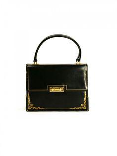 so lady like... 1950's lampron leather handbag.