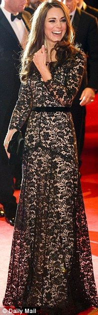 Kate wearing a designer dress by Temperley, which costs around 1,000 pounds - black lace overlay on a nude base.  She wore this to the premiere of THE WAR HORSE.