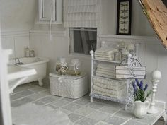 Love the tiles, roman blinds, towels.