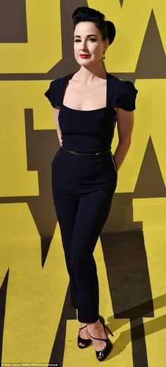 All curves: Burlesque dancer Dita Von Teese showed off her hourglass figure as she arrived...