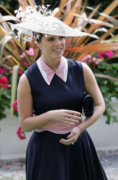 Eugenie kept her accessories to the minimum with a few gold rings, a slender gold chain on her wrist and a modest clutch bag