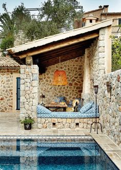 Poolside with ikat designed lounge seating   Bureaux House   #poolside #relax #minimal #design #outside #space #stone #josephcarinicarpets