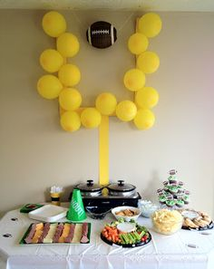 Football party idea!  The yellow posterboard and yellow balloons cost under $2.00.  I would suggest tacks for hanging it up.  Find any football that you can hang and ta da!