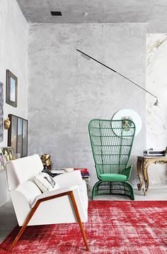 seating & cement walls are the perfect back drop for a bright, unexpected interior.