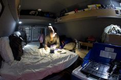 simple cosy van conversion, good storage ideas, shelving all around the top