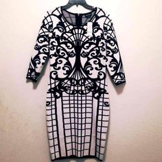 Bebe dress NWT Beautiful 3/4 sleeve Bebe dress. Will fit 12/14 and up to 16 due to stretch. Print of dress flatters shape of body. NWT.  For measurement I'm 5'2 and dress lands at my knees. Material 54% Nylon 46% Rayon No Trades ✨Final Price✨ bebe Dresses Midi