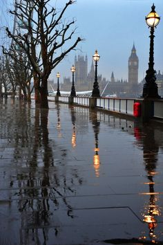 London, England - a view of the Thames River and Big Ben in the rain