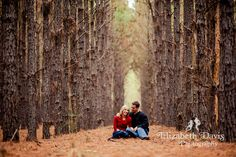 Couple sits in long row of pine trees forest | Georgia farm engagement session | outdoor engagement photos | Scot & Katy | Elizabeth Davis Photography | Click here to see the whole session: http://elizabethdavisphotoblog.com/scot-katy-engagement-session/