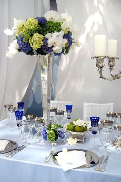 Orchids, hydrangea and gerbera daisies make for a fresh, modern wedding centerpiece.