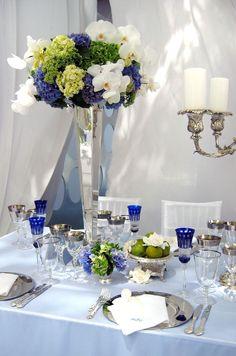 Orchids, hydrangea and gerbera daisies make for a fresh, modern wedding centerpiece.