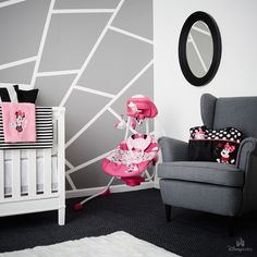 A bold statement wall & bright pops of pink complete this Minnie-inspired…