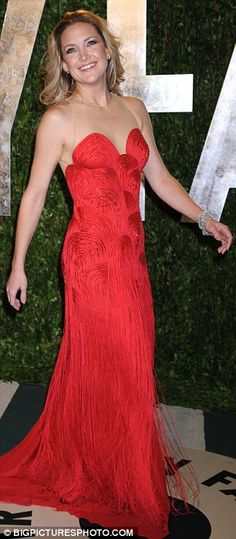 Kate Hudson looked ravishing in a red fringed and beaded gown