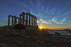 Temple of Poseidon at sunset, Cape Sounion, Athens, Greece   which is the southernmost point of the Attica prefecture  .   The temple was built  in the 5th century BC in honour of God Poseidon, master of the seas and oceans. The temple is built having 6 pillars in the shorter sides and 13 in the longer ones.