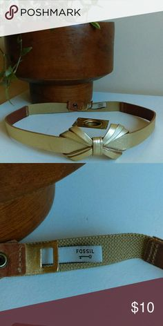 Fossil Gold Leather Bow Belt Super girly and fun belt. I loved wearing it over dresses. Size Medium! Gold leather, stretchy material on the back part of belt and snap closure. Great condition. Fossil Accessories Belts