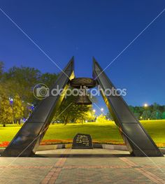 Memorial monument with bell in park near Donbass Arena Stadium i - Стоковое изображение