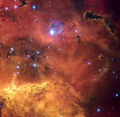 A colourful star-forming region is featured in this stunning new NASA/ESA Hubble Space Telescope image of NGC 2467. Looking like a roiling cauldron of some exotic cosmic brew, huge clouds of gas and dust are sprinkled with bright blue, hot young stars.  Strangely shaped dust clouds, resembling spilled liquids, are silhouetted against a colourful background of glowing. Like the familiar Orion Nebula, NGC 2467 is a huge cloud of gas — mostly hydrogen — that serves as an incubator for new…