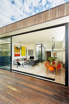 The Malvern House is a semi-detached residence that was designed by Jost Architects. The bright pop-up colors add more life and vibrancy to the white and gray interiors. The house is located in Mel…