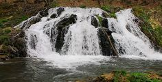Waterfall In The Forest by nspasov Beautiful waterfall in the forest in spring