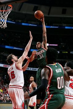 John Henson #31 of the Milwaukee Bucks shoots against the Chicago Bulls on January 10, 2015 at the United Center in Chicago, Illinois.  (Photo by Gary Dineen/NBAE via Getty Images)